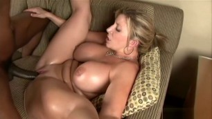 Chubby big tit Blonde MILF Donita gives head to a giant black pecker and gets tapped