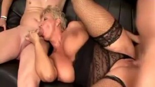 German granny fucks with a man on a black couch 1
