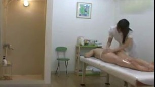 Female asian massage - her body in oil